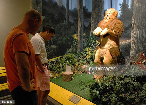 STORY by Olivia Blanco Mullins Armando Cruz of Laredo Texas at an exhibit featuring the Cowardly Lion from the Wizard of Oz with his friend Daniel...