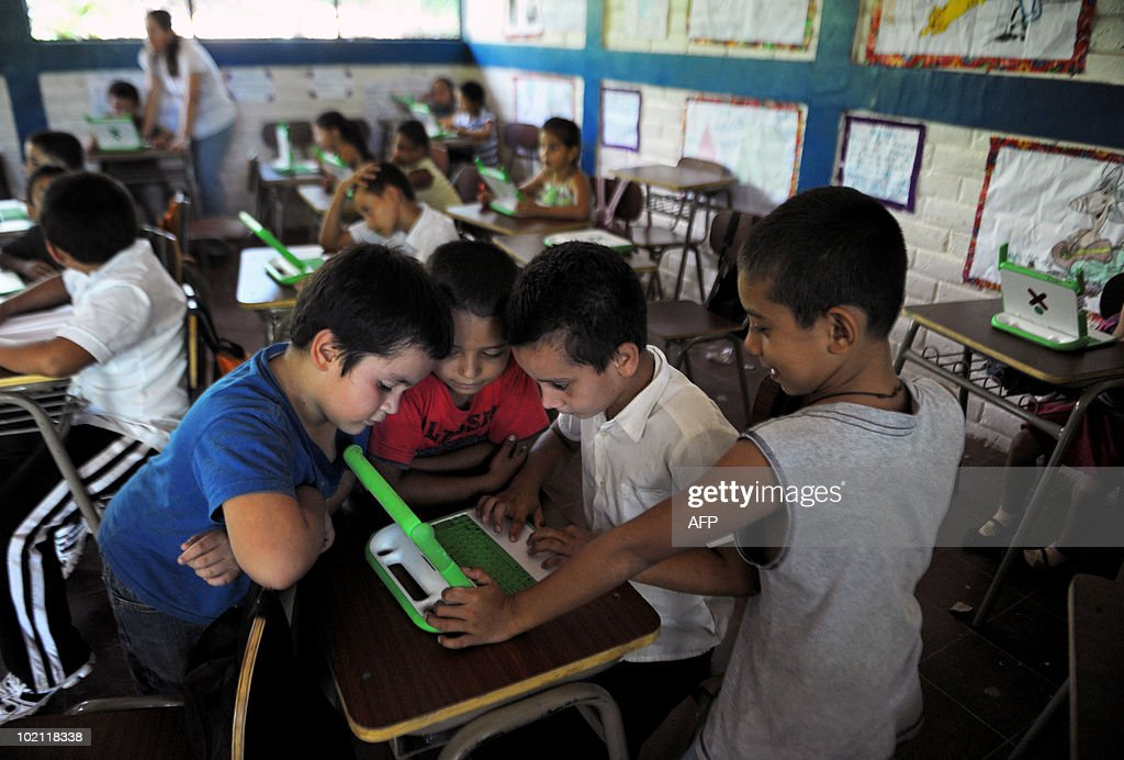 STORY by OSCAR BATRES - Children work with an OLPC XO laptop in the Hacienda Vieja elementary school in the town of Nombre de Jesus, 90km north from San Salvador on June 14, 2010. The Salvadorean Ministry of Education launched the 'Closing the gap of knowledge' project aimed at improving educational processes with technology, for students in very poor agricultural areas of El Salvador. AFP PHOTO/Jose CABEZAS