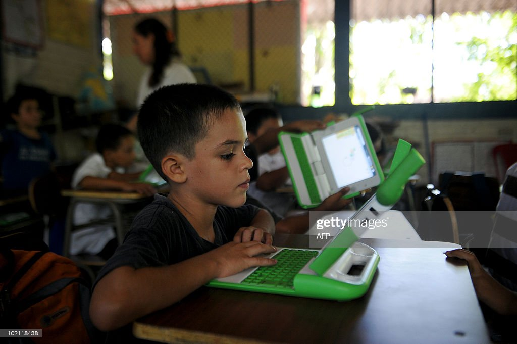 STORY by OSCAR BATRES - Juan Jose Flores works on an OLPC XO laptop in the Hacienda Vieja elementary school in the town of Nombre de Jesus, 90km north from San Salvador on June 14, 2010. The Salvadorean Ministry of Education launched the 'Closing the gap of knowledge' project aimed at improving educational processes with technology, for students in very poor agricultural areas of El Salvador. AFP PHOTO/Jose CABEZAS