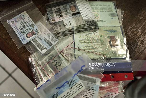 STORY by Oscar Batres Picture of identification cards and passports of Salvadoran deportees taken at the immigration office in Comalapa International...