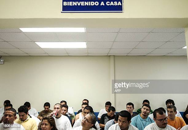 STORY by Oscar Batres Salvadorans deported from the US wait in the immigration office at Comalapa International Airport 44 km south of San Salvador...