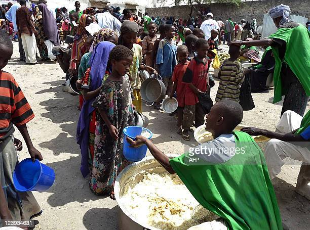 By Otto Bakano Photo made on September 5 2011 shows children receiving food at a WFPfeeding centre in Somalia's capital Mogadishu where more than...