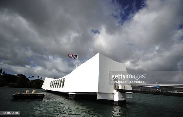 STORY by Patrick BAERT US Visitors tour the USS Arizona memorial at the Pearl Harbour historical site and memorial in Honolulu Hawaii on November 9...