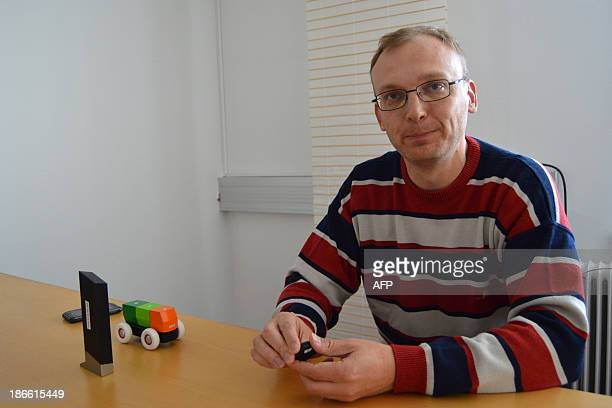 STORY by PAULINE CURTET Picture taken on October 4 2013 shows Kimmo Saarela the CEO of TreLab in the Finnish city of Tampere demonstrating a...