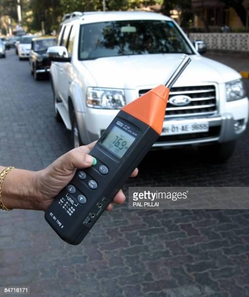 STORY 'LIFESTYLEINDIAHEALTHNOISEPOLUUTION' by Phil Hazlewood Environmentalist Sumaira Abdulali uses a noise meter to check noise levels in Mumbai on...