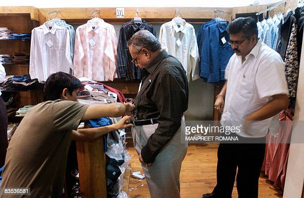"""By Phil Hazlewood : In this file photograph taken 13 September 2006, Chandan Widhani, , owner of plus-sized clothing store """"Just My Size"""" watches as..."""