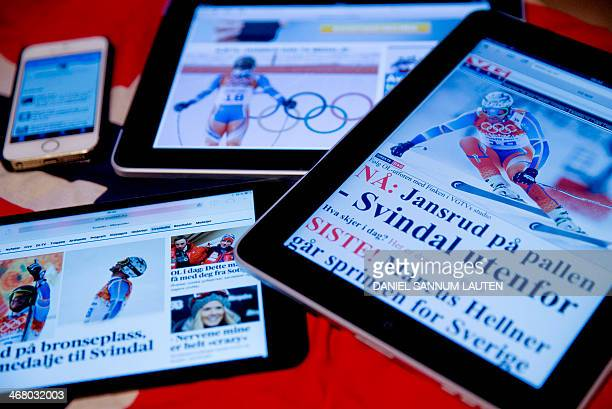 STORY by PIERRE Norwegian newspapers' tablet editions and a phone with twitter seen minutes after the mens downhill race during the Sochi Winter...