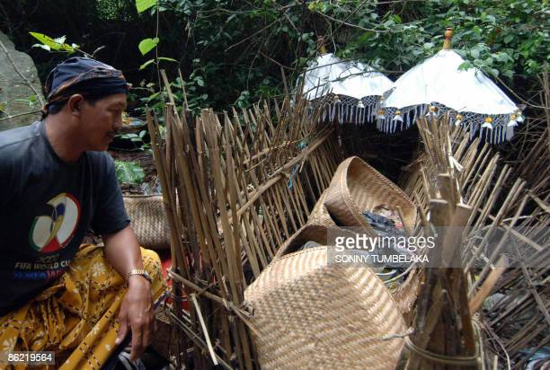 STORY INDONESIABALICULTUREDEATH by Presi Mandari A Balinese man sits next to a grave near a banyan tree protected by bamboos at Trunyan village in...