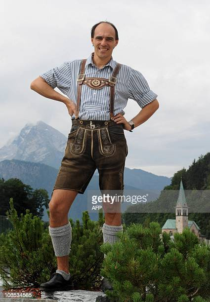 STORY by RALF ISERMANN Leather tailor Franz Stangassinger dressed in leather trousers and traditional Bavarian clothes poses in front of the Watzmann...