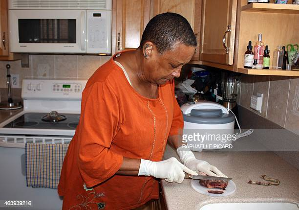 STORY by Raphalle PICARD US Claudia Booker prepares pieces of human placenta and umbilical cord for dehydration February 9 in Washington DC Booker a...