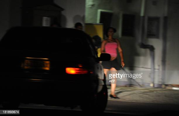 STORY by Refentse Moyo A picture taken on November 3 2011 shows an unidentified prostitute waiting for clients on a street in Gaborone Botswana's...