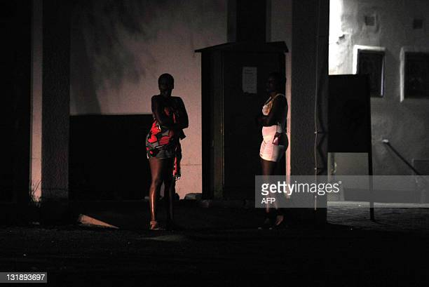 STORY by Refentse Moyo A picture taken on November 3 2011 shows two unidentified prostitutes waiting for clients on a street in Gaborone Botswana's...
