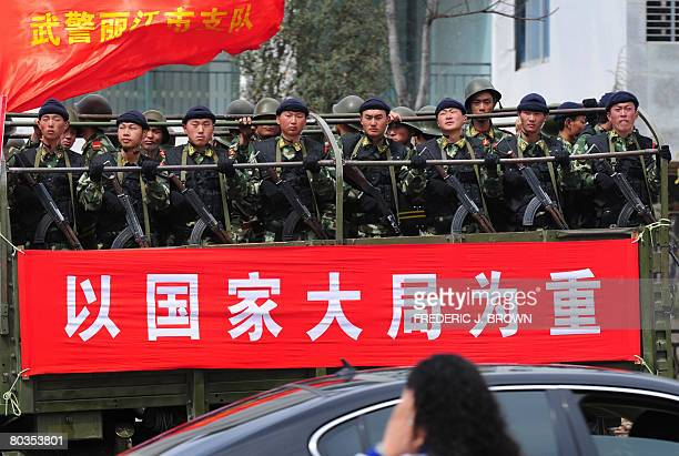 SHANGRILA by Robert Saiget Armed paramilitary police are paraded by the truckload along the streets of Lijiang south of Shangrila on March 24 2008 in...