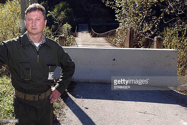 By Rusmir Smajilhodzic Mladen Mauhar, a local Croatian forester stands in front of blocked local bridge over Kupa river which makes a border between...