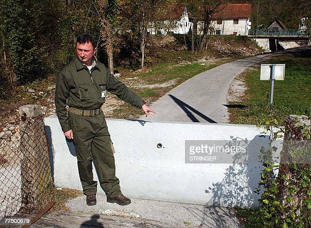 By Rusmir Smajilhodzic Recent picture of Mladen Mauhar, a local Croatian forester showing a blocked local bridge over Kupa river which makes a border...