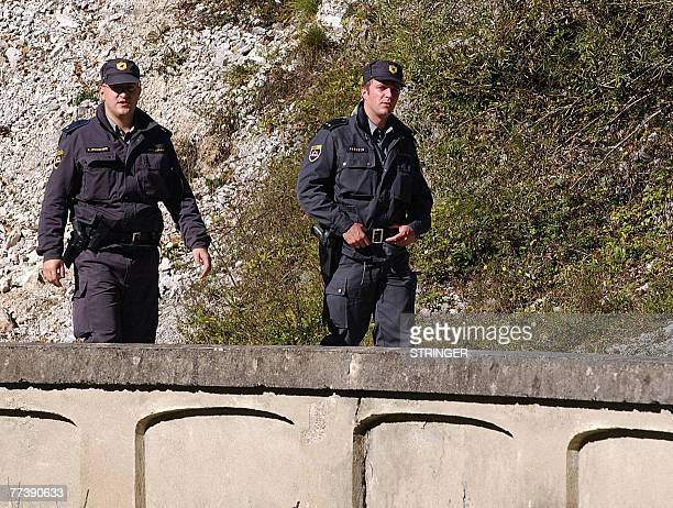 By Rusmir Smajilhodzic Slovenian border police patrol at blocked local bridge over Kupa river which makes a border between Croatia and Slovenia in...