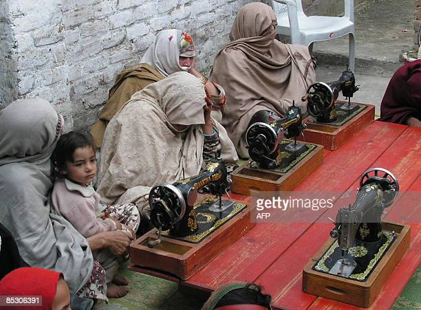 STORY 'WOMENRIGHTSPAKISTANUNRESTNORTHWEST' by Saad Khan Veiled women sit beside sewing machines during a class at a vocational training center at...