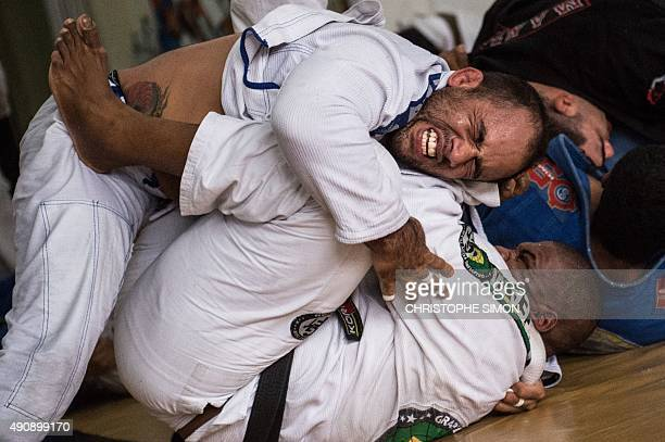 STORY by Sebastian Smith Brazilians practice jiujitsu in Rio de Janeiro Brazil on September 14 2015 Once restricted almost entirely to the Latin...