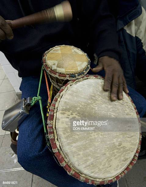 By Sebastian Smith, Lifestyle-economy-US-music-transport A drummer performs at the Number 4 6 subway station in Harlem February 4, 2009 in New York....