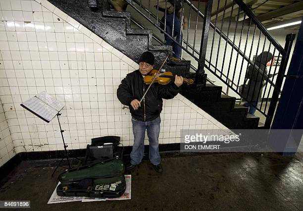 By Sebastian Smith, Lifestyle-economy-US-music-transport Manuel Espinoza plays the violin at the Number 6 Subway train's 68th street station January...