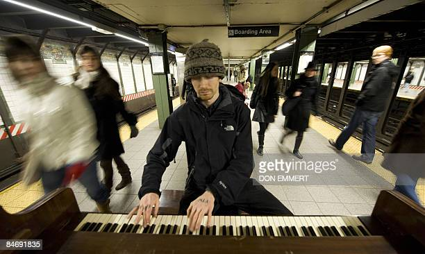 By Sebastian Smith, Lifestyle-economy-US-music-transport Pianist Colin Huggins plays for subway riders at the Union Square station January 31, 2009...