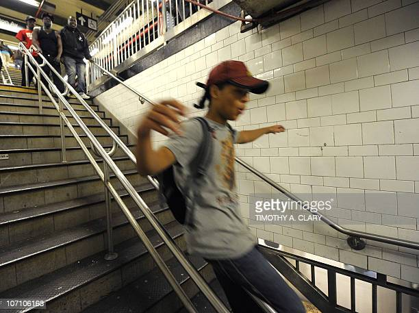 CULTURE by Sebastian Smith New York City Subway dancer Marcus Walden aka Mr Wiggles slides down a railing in the subway November 23 2010 The dance...