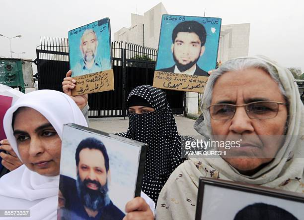 WITH PAKISTANJUSTICEPOLITICSMISSING FOCUS by Shafiq Ahmad Pakistani women hold pictures of their missing relatives outside the Supreme Court building...