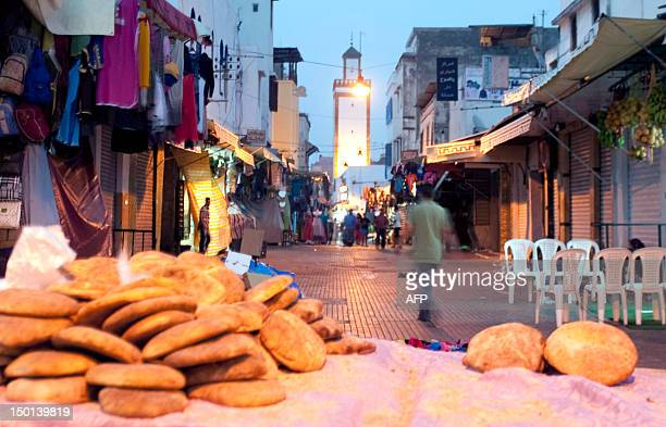 STORY by Simon Martelli A picture taken on August 10 2012 shows a street of the medina in Rabat during Ramadan The seats outside cafes are empty and...