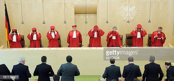 STORY by SIMON MORGAN FILES Picture taken on June 19 2012 shows judges of the Second Senate of Germany's Federal Constitutional Court standing up to...