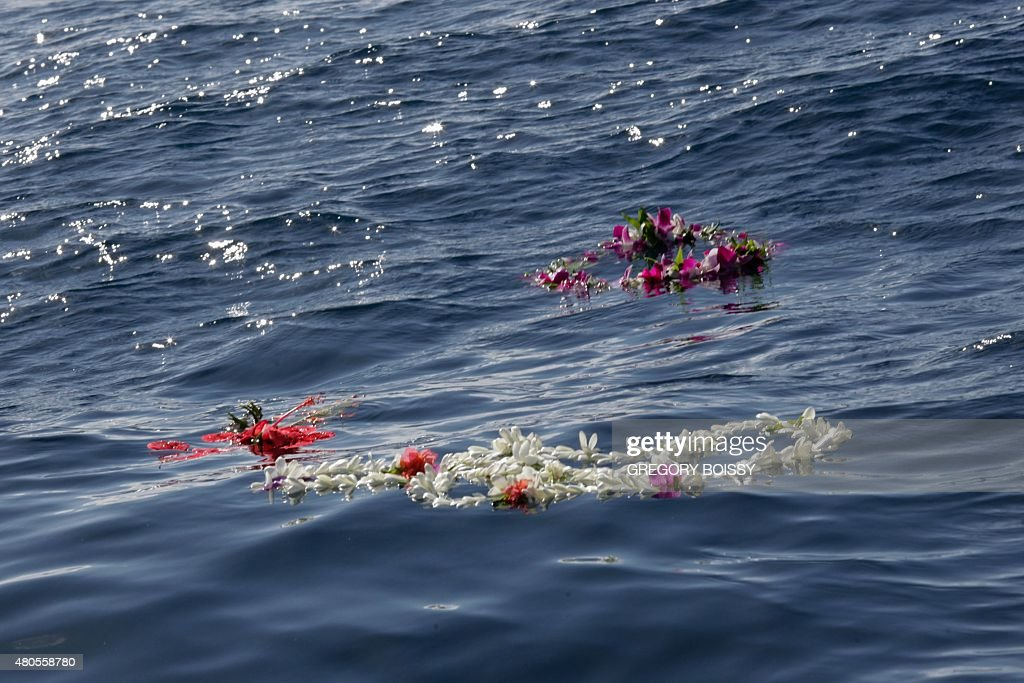 STORY by Sophie LAUTIER A picture taken on July 12, 2015 shows flower garlands during a ceremony to pay tribute to Swiss yachtsman Laurent Bourgnon, near Papeete. Swiss yachtsman Laurent Bourgnon was reported missing on June 24 after failing to return from a diving trip off the remote atoll of Toau, French Polynesia. Bourgnon was one of leading lights of ocean racing in the 1990s, notably winning the gruelling single-handed transatlantic Route du Rhum race from France to the Caribbean island of Guadeloupe twice, in 1994 and 1998.