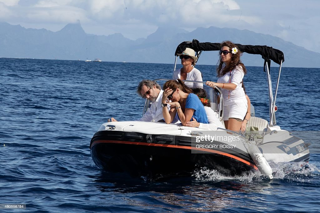 STORY by Sophie LAUTIER Caroline Bourgnon (C), the wife of Swiss yachtsman Laurent Bourgnon, reacts during a ceremony to pay tribute to her husband in Papeete on July 12, 2015. Swiss yachtsman Laurent Bourgnon was reported missing on June 24 after failing to return from a diving trip off the remote atoll of Toau, French Polynesia. Bourgnon was one of leading lights of ocean racing in the 1990s, notably winning the gruelling single-handed transatlantic Route du Rhum race from France to the Caribbean island of Guadeloupe twice, in 1994 and 1998.