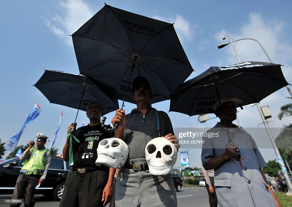 By STEPHEN COATES Indonesian activists march toward the parliament carrying skulls as a symbol of Suharto's tyranny marking the anniversary of the downfall of the military strongman in Jakarta on May 21, 2010. Twelve years after the dawning of Indonesia's 'Reformasi' movement with the resignation of military strongman Suharto, there are fears the country of 240 million people is on a slipperly slope backwards.