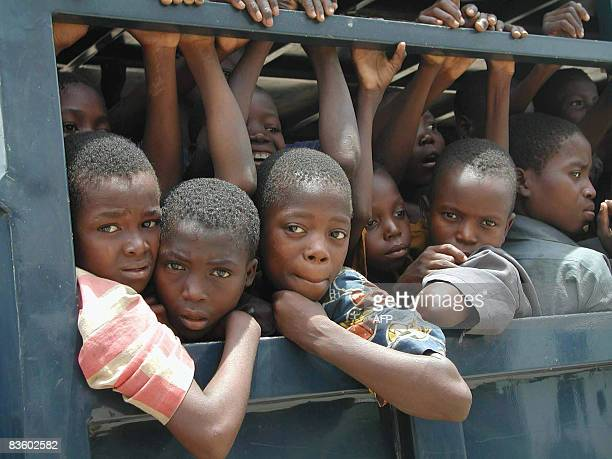 STORY by Susan Njanji This photo taken on September 26 2003 shows dozens of slave children ridding in the back of a police vehicle after their...