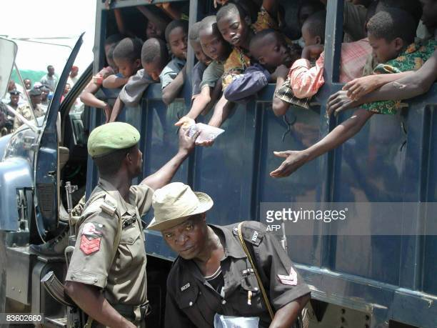 STORY by Susan Njanji This photo taken on September 26 2003 shows dozens of slave children being given bagged water in the back of a police vehicle...