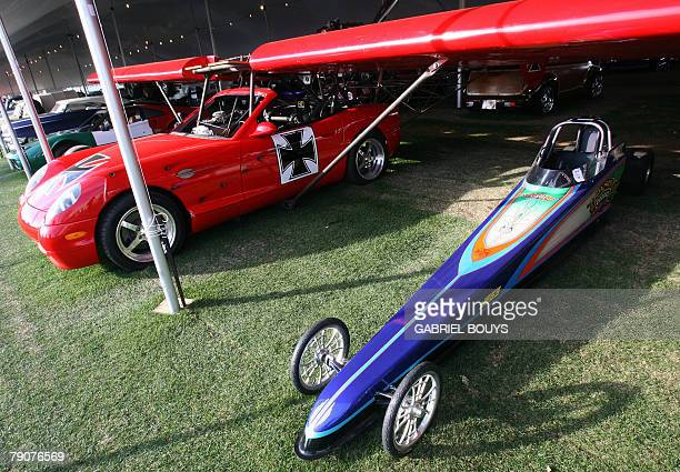 STORY by Tangi QUEMENER USAsocitautomobileenchres A dragster and a flying car are seen during the 37th Annual BarrettJackson classic automobile...
