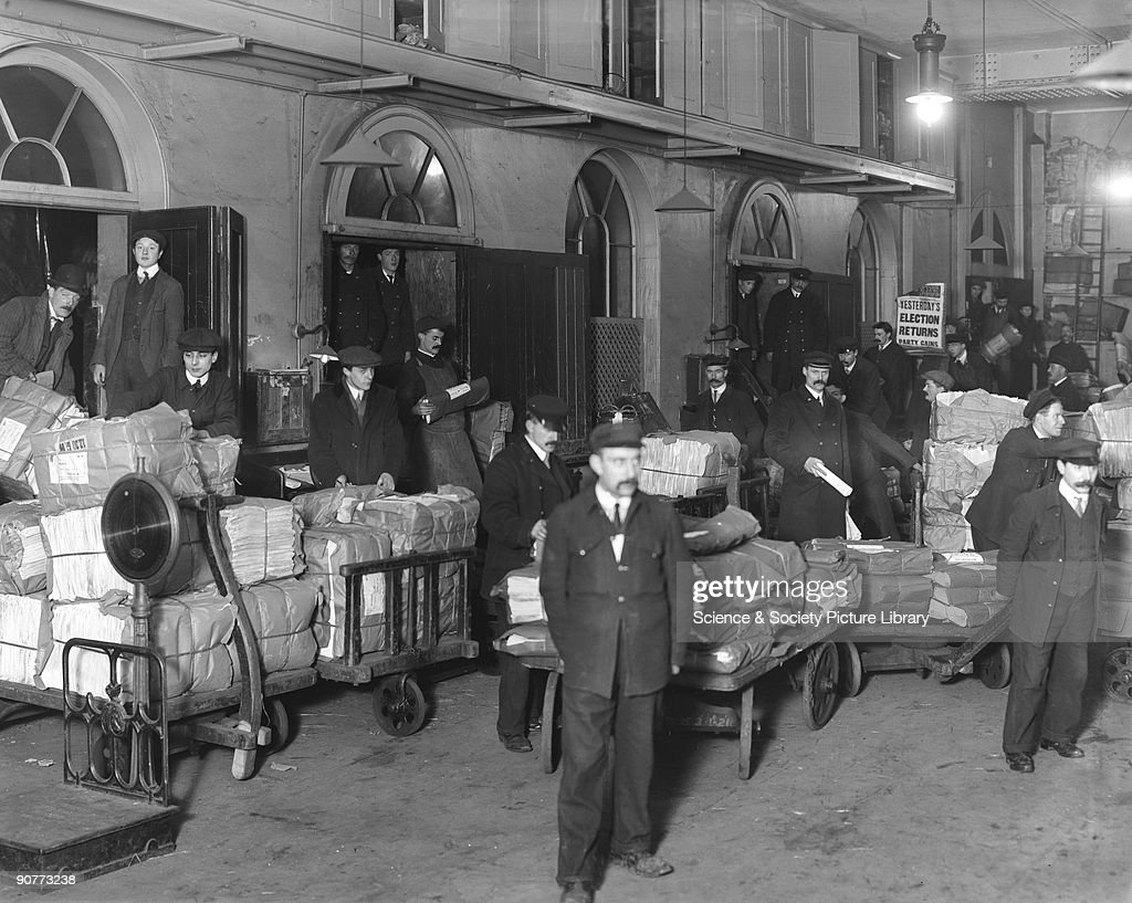 Newspapers being loaded onto a train, Paddington Station, London, c 1910. : News Photo