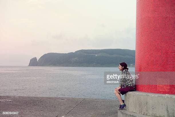 by the red lighthouse - sea of okhotsk stock pictures, royalty-free photos & images