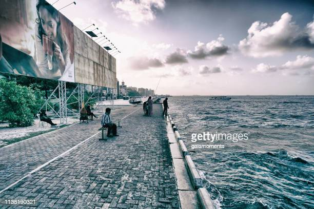 by the waterfront in malé, maldives - male maldives stock pictures, royalty-free photos & images