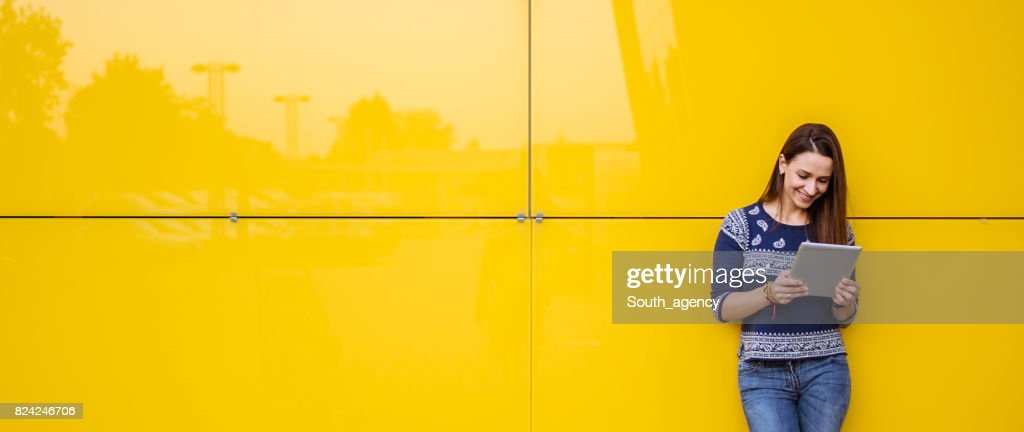 By the yellow wall : Stock Photo