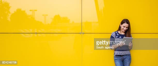 By the yellow wall