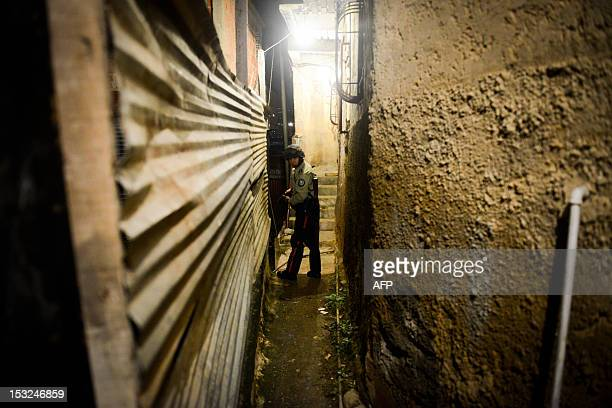 STORY by Valeria Pacheco A municipal police officer patrols the alleys of the impoverished Petare neighbourhood one of Caracas' most dangerous slums...