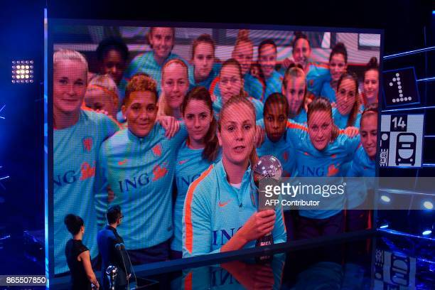 TOPSHOT By videolink Barcelona and Netherlands midfielder Lieke Martens holds her trophy for The Best FIFA Women's Player of 2017 Award during The...