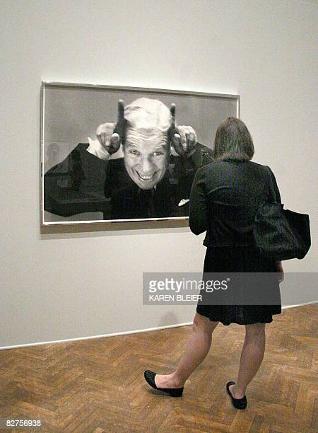 POLITICS by Virginie Montet A journalist looks at Richard Avedon's Charles Chaplain Leaving America photo on September 10 2008 during a press preview...