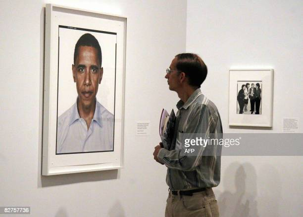 POLITICS by Virginie Montet A man looks at a portrait of Barack Obama taken in 2004 by photographer Richard Avedon September 10 2008 during a press...