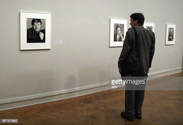POLITICS by Virginie Montet A man looks at a portrait of MIchael Moore taken in 2004 by photographer Richard Avedon September 10 2008 during a press...