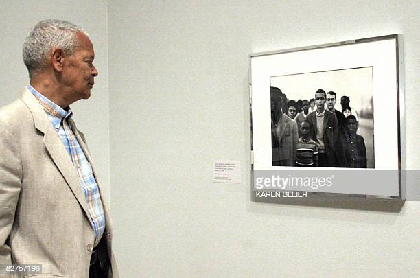 POLITICS by Virginie Montet Julian Bond Chairman of the NAACP looks at a portrait of himself in 1963 when he was a member of the Student Nonviolent...