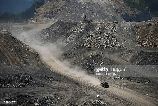 STORY by Virginie MONTET USAenvironmentenergypollution A June 12 2008 photo shows a truck leaving a trail of dust as it speeds across a coal mine on...