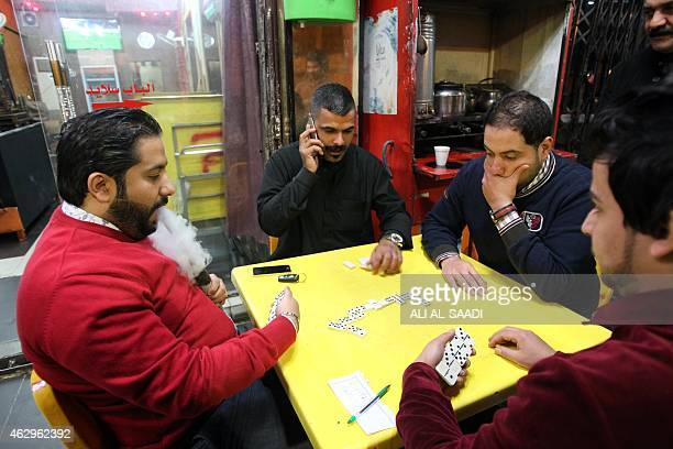 STORY by WG Dunlop IraqSyriaconflictUSBaghdadcurfew Iraqis at a cafe play domino on February 8 after curfew was lifted in Baghdad Iraqis roared...