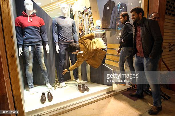 STORY by WG Dunlop IraqSyriaconflictUSBaghdadcurfew Iraqis vivit a clothes shop on February 8 after curfew was lifted in Baghdad Iraqis roared...