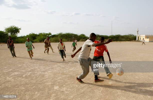 STORY by William Davies A picture taken on June 12 2012 shows young boys playing football in a dusty field in Hudur On the patch of scrub land...